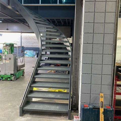 Steel beam curved stairs